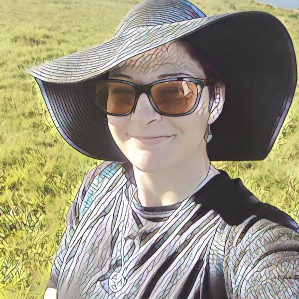 edited image of the author outside wearing a large brimmed hat